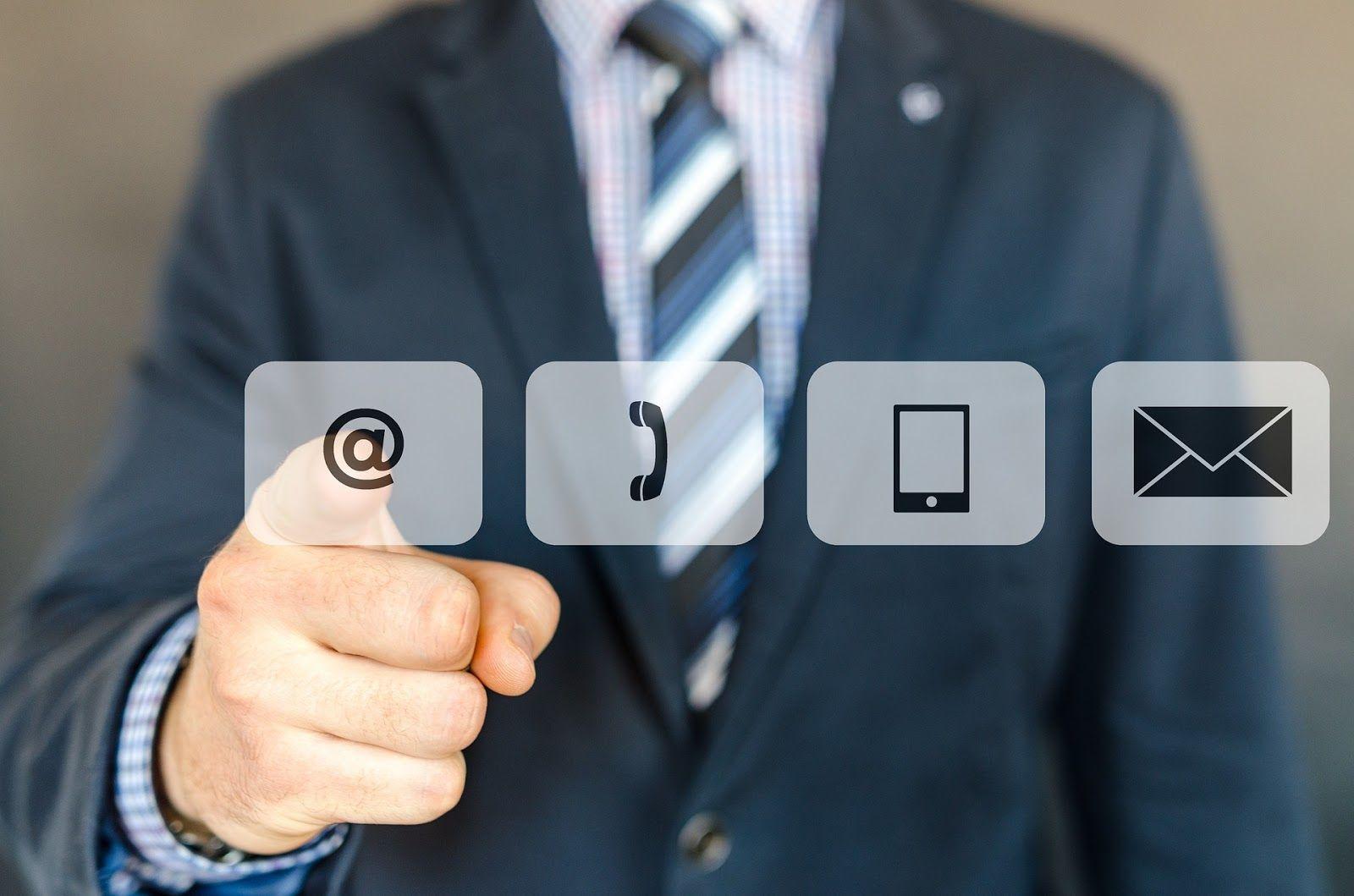 Man pointing at the at symbol for social media lead nurturing