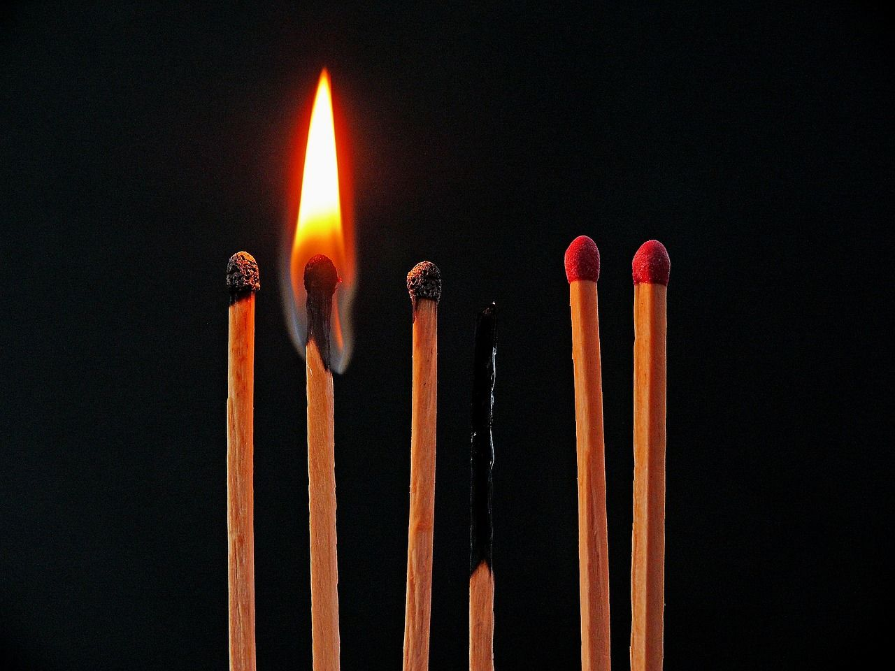 row of matches burning