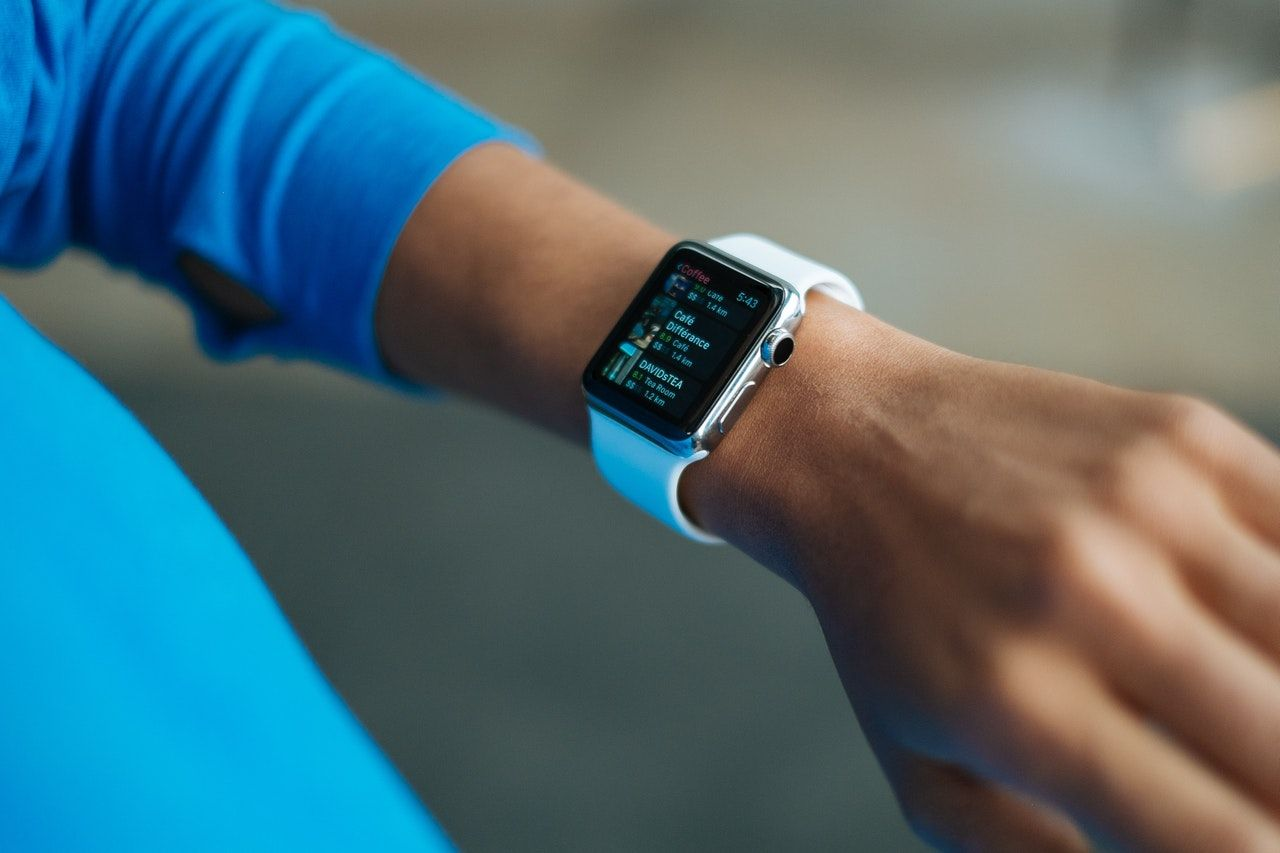 close up of a wrist with a smart watch