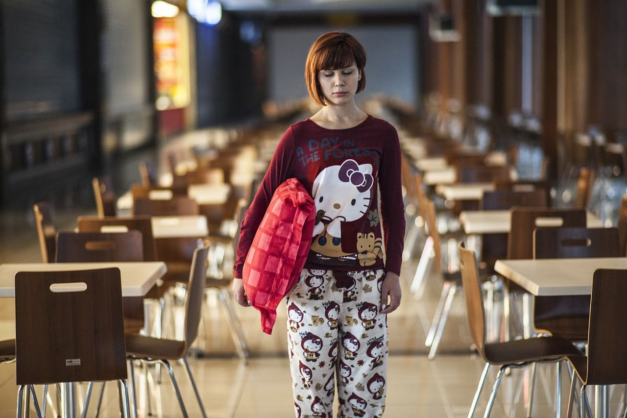 woman in pyjamas unable to sleep