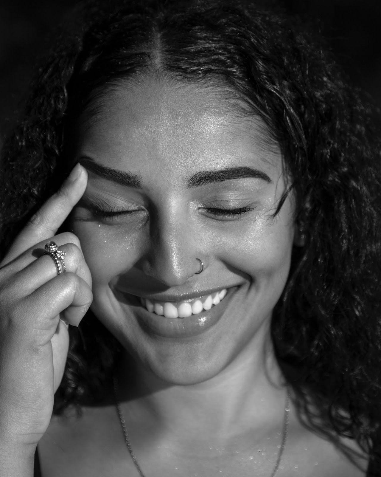 woman smiles and raises her eyebrow