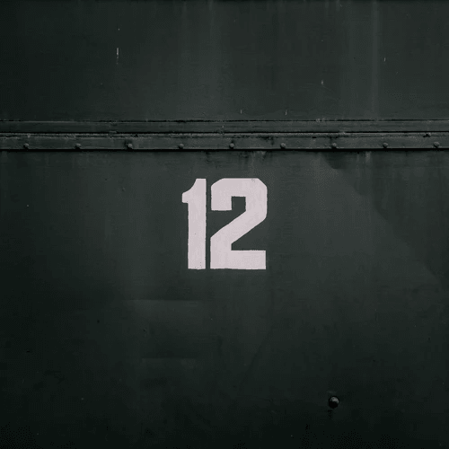 The number 12 on a dark green background.
