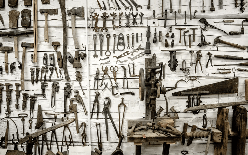 A wall filled with different kinds of tools.