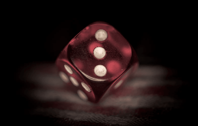A red die set to the number three.