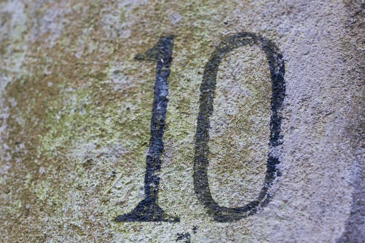 The number 10 written on concrete.