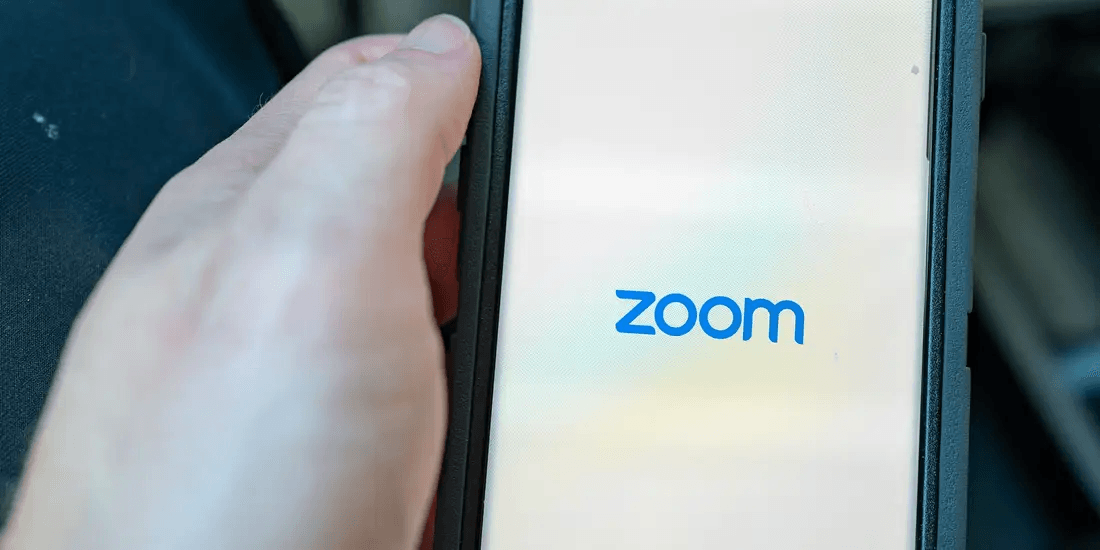 Person activating Zoom on their mobile phone.