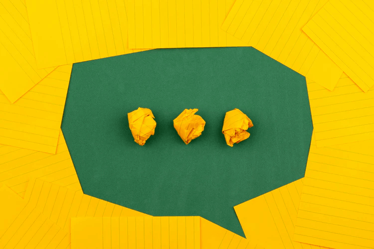A speech bubble made with yellow and green paper.