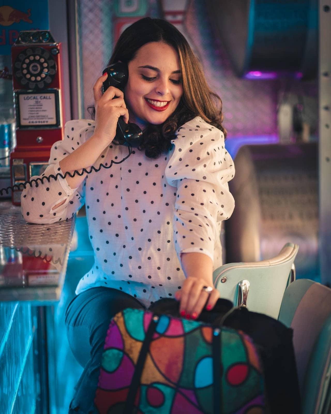 retro woman talking on a landline phone