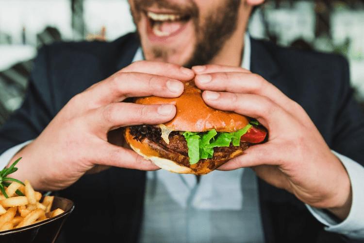 A man eating a hamburger