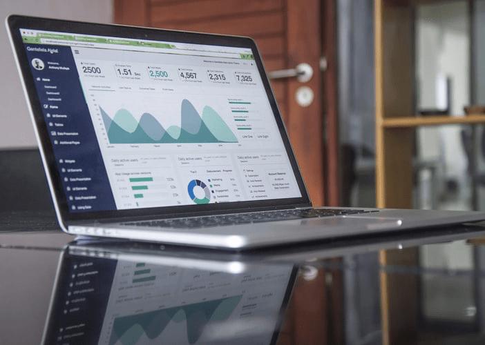 A computer displaying business metrics.