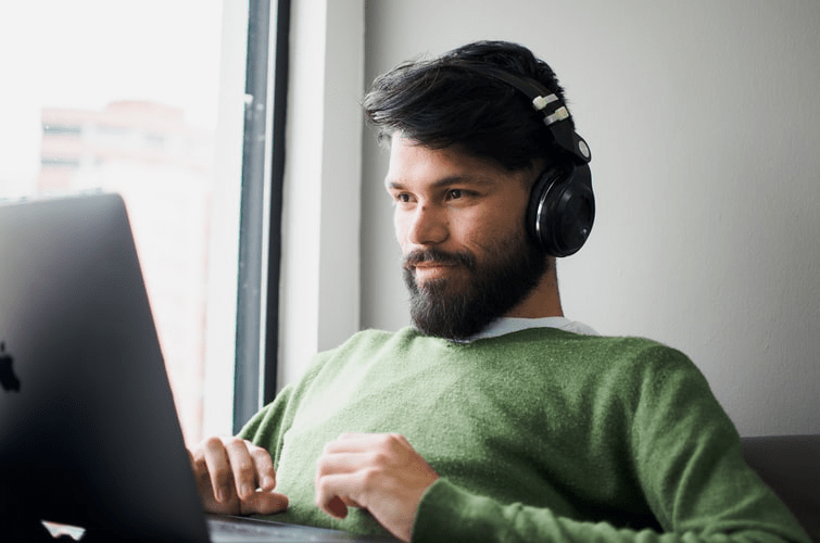 A man happily working remotely.