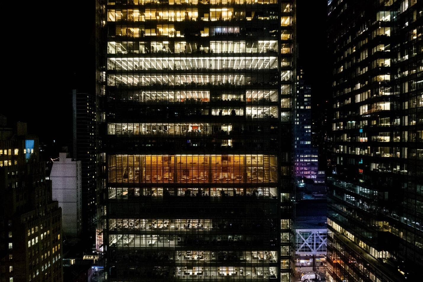 New York City office lit up at night