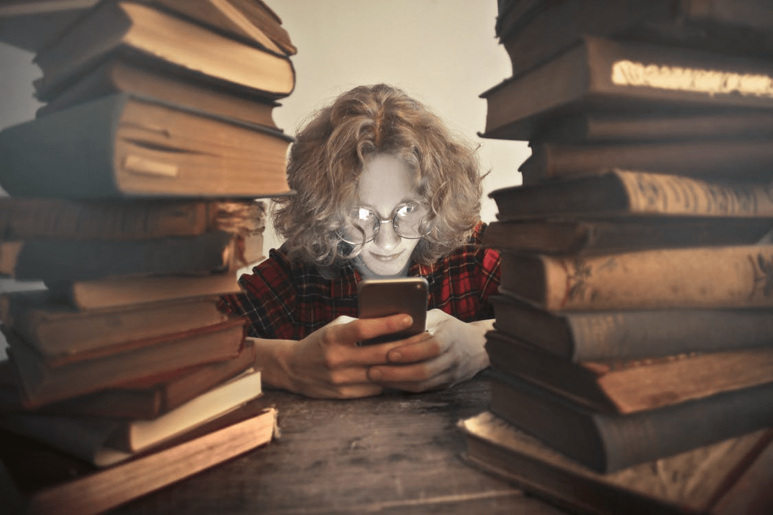alternative to Google kid with cell phone among books