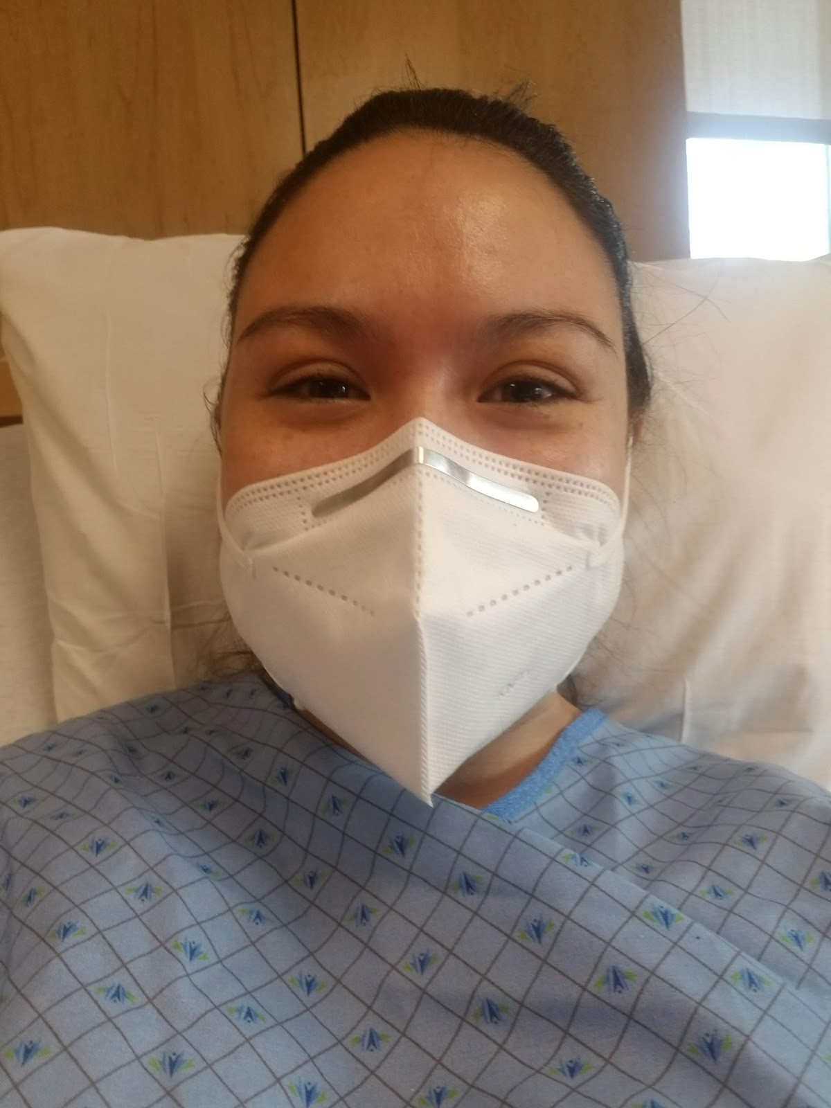 Maile Waite in a mask in the hospital