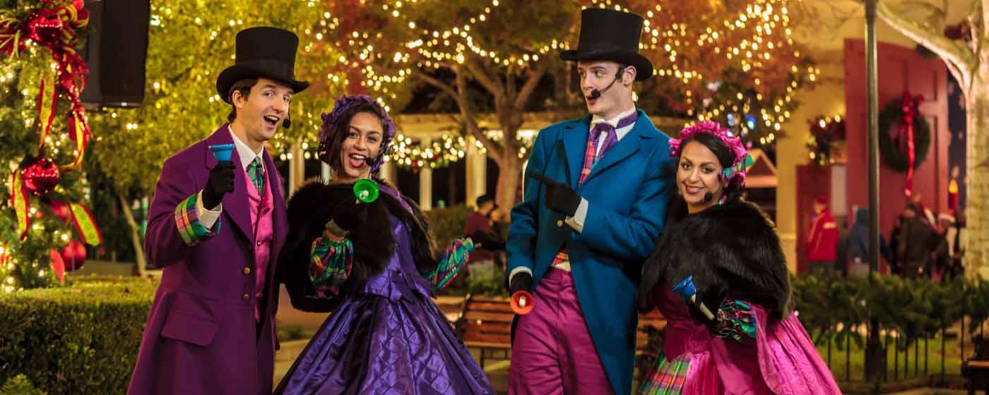 four christmas carolers