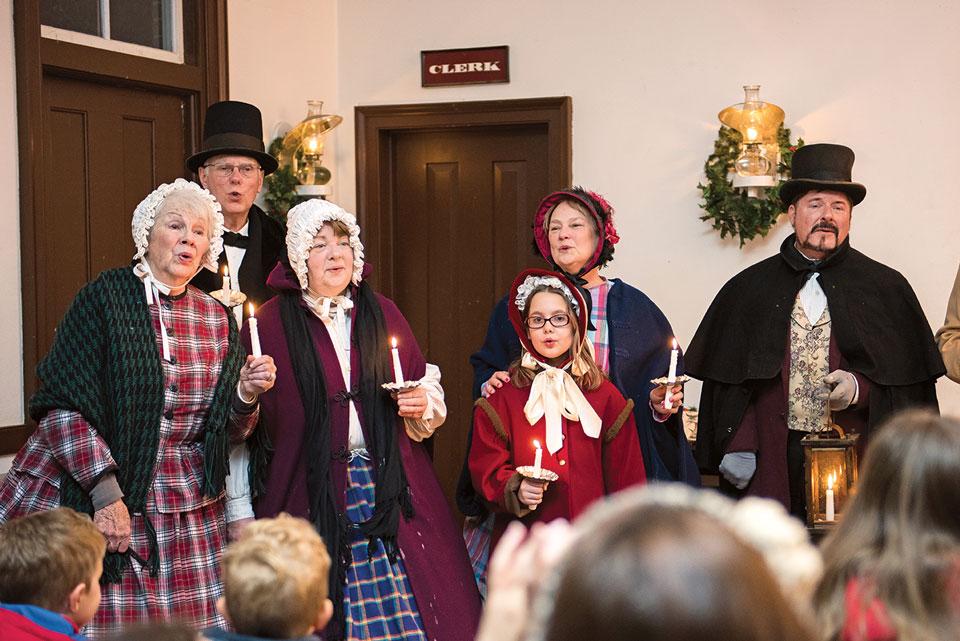 family of christmas carolers