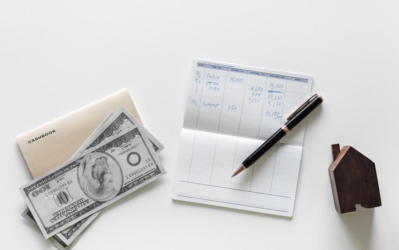 money, checkbook & wooden home block