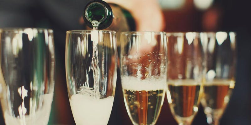 """champagne poured into glasses for """"No 'Pagne, No Gain"""" New Year's Eve Wine Dinner"""
