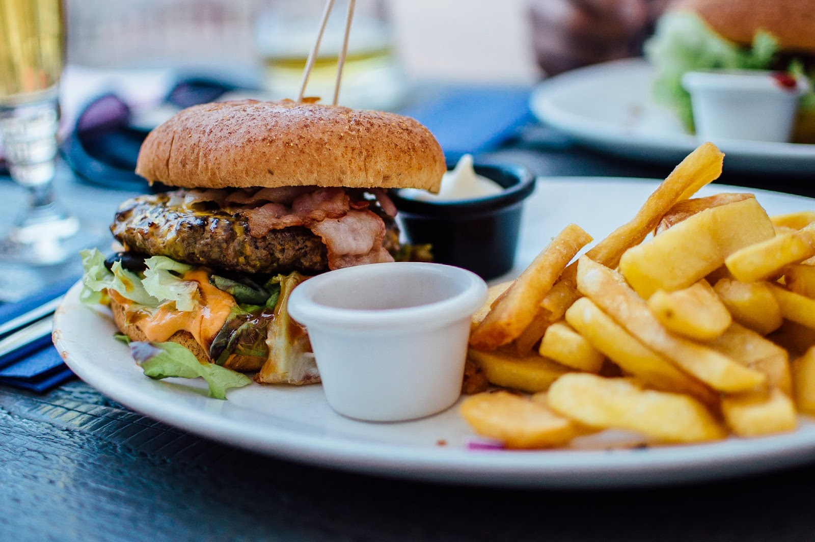 cheeseburgers and fries on a plate from Indian Head Roadhouse