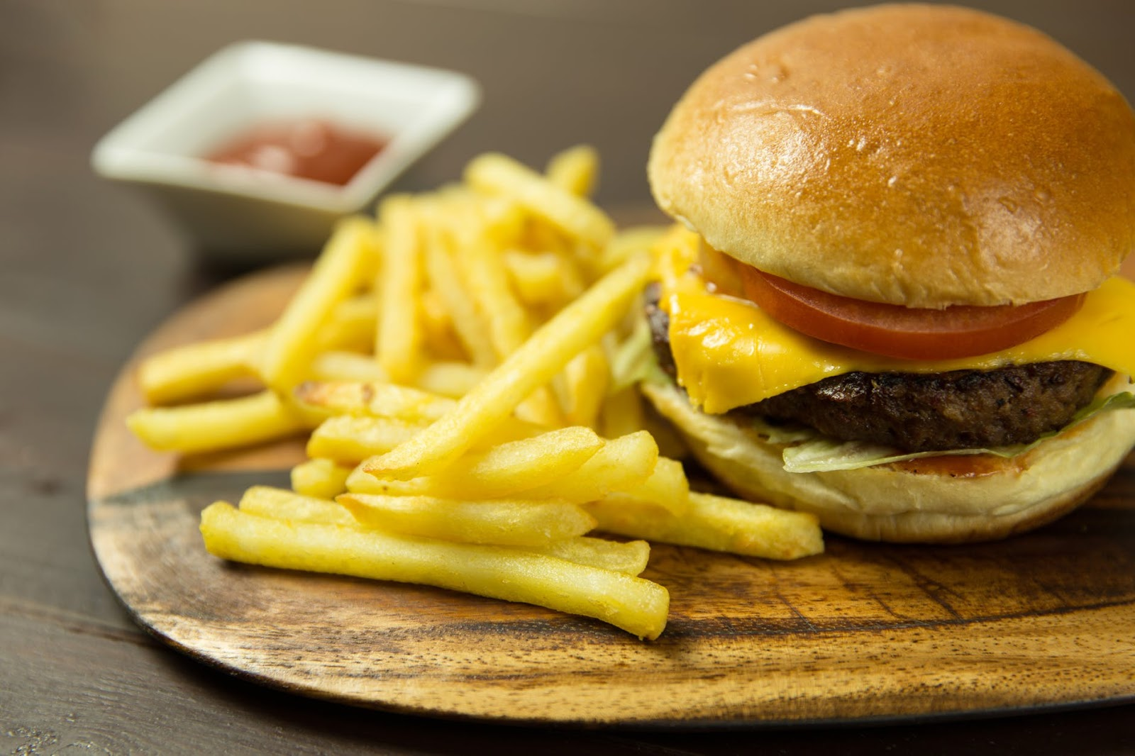 cheeseburger and fries on a wooden tray from Landing Tavern
