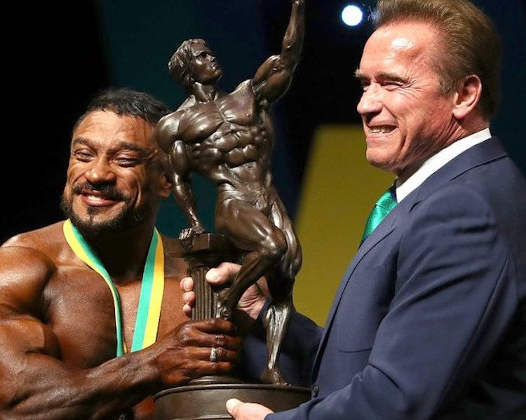 Arnold & winner holding Arnold Classic trophy