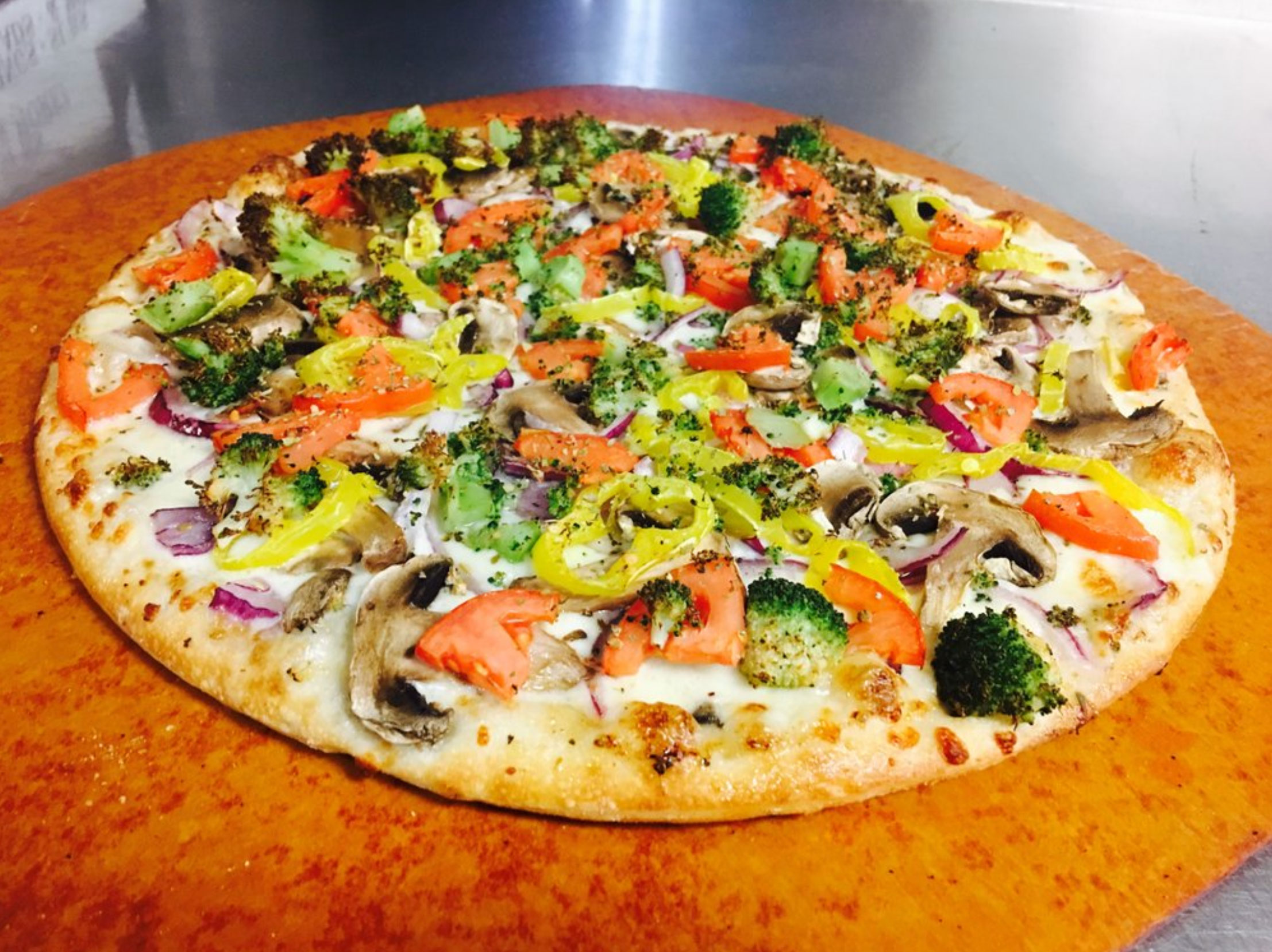 Banana peppers mushrooms tomatoes onions broccoli cheese pizza vegetables