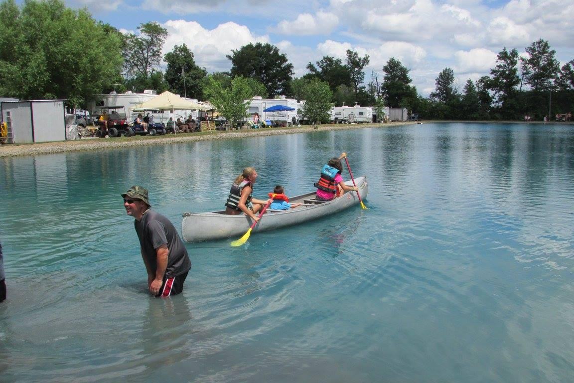 three girls canoeing at Blue Water Campground