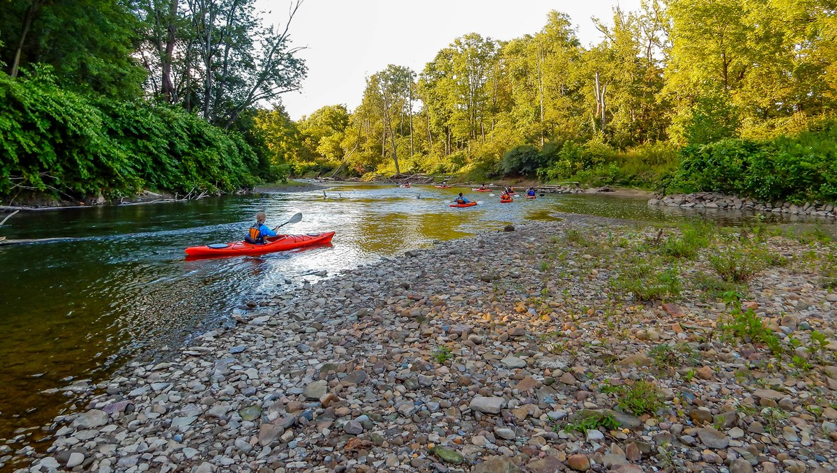 people canoeing down creek in Cuyahoga Valley National Park