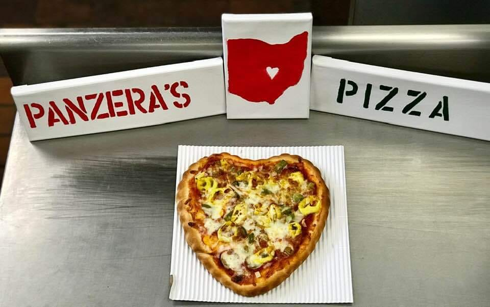 a heart shaped pizza on the counter of panzera's pizza in upper arlington ohio
