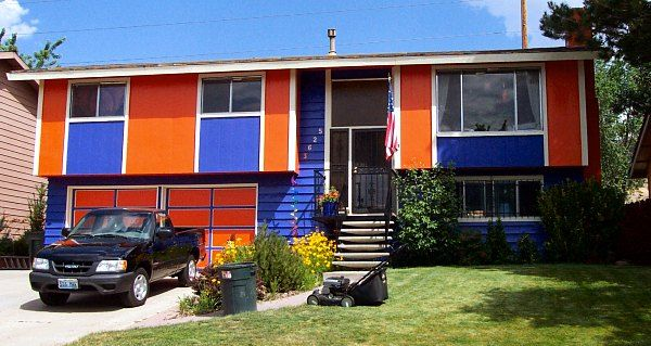 Blue and orange two-story home with truck in driveway