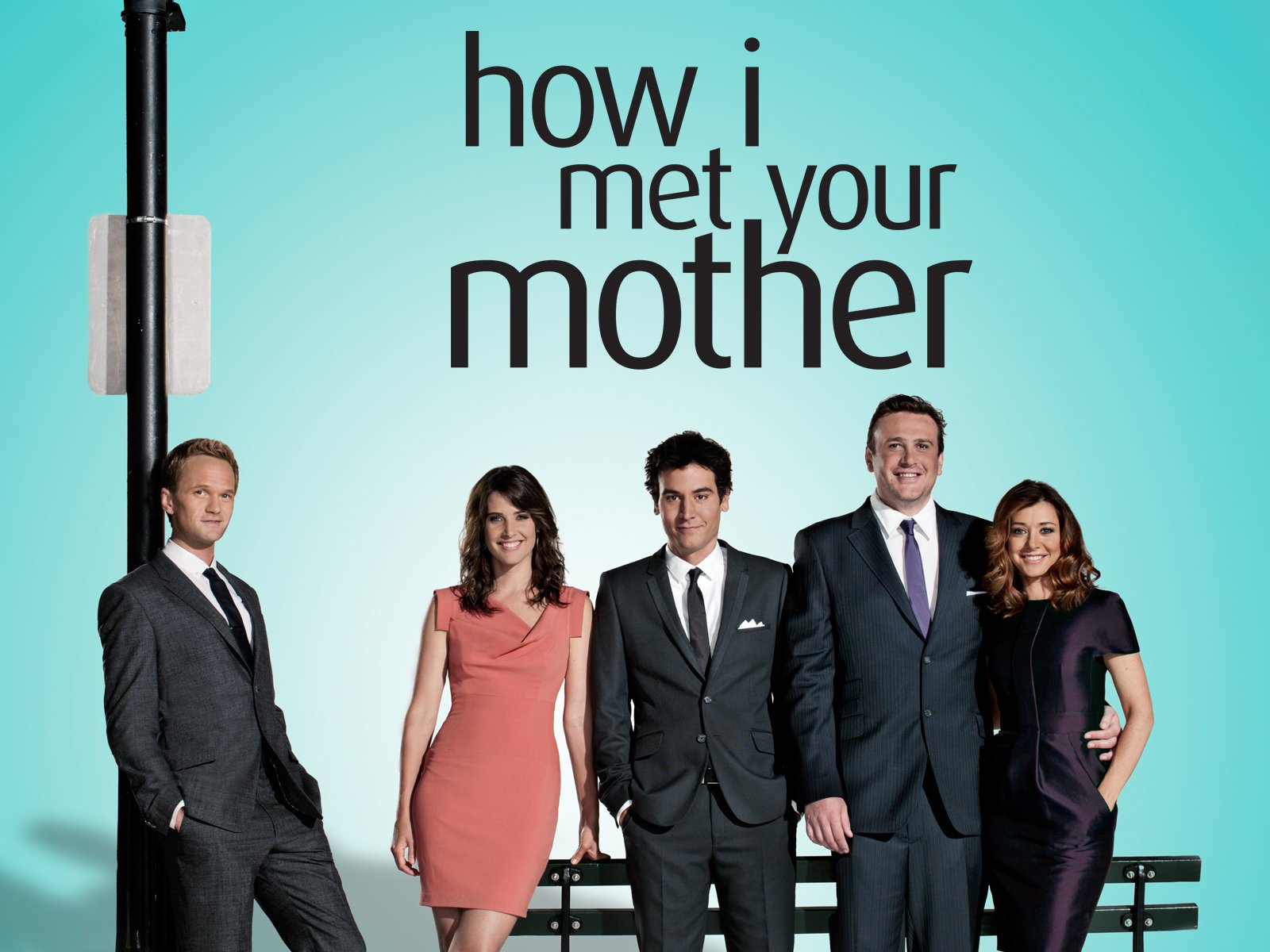 The cast of How I Met Your Mother stand smiling in formal wear