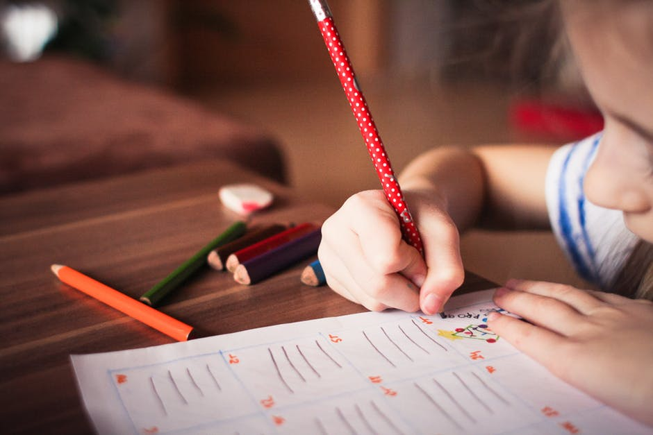 close-up of a young girl doing schoolwork