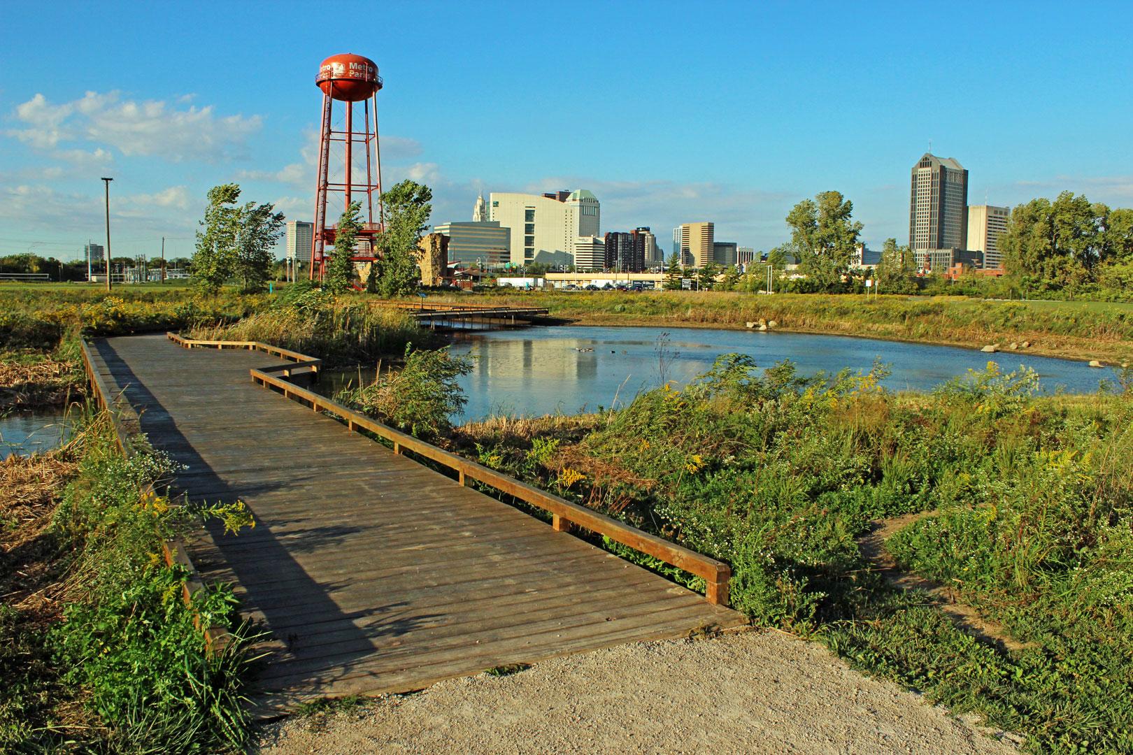 small wooden bridge and watertower at Scioto Audubon Metro Park