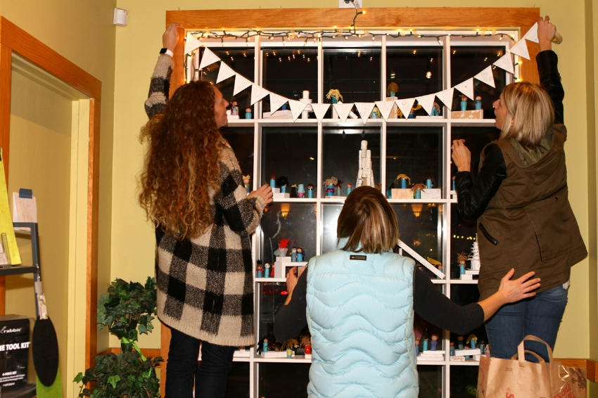 women decorating window