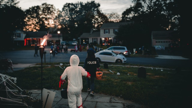 children trick or treat in a cul de sac on  halloween night
