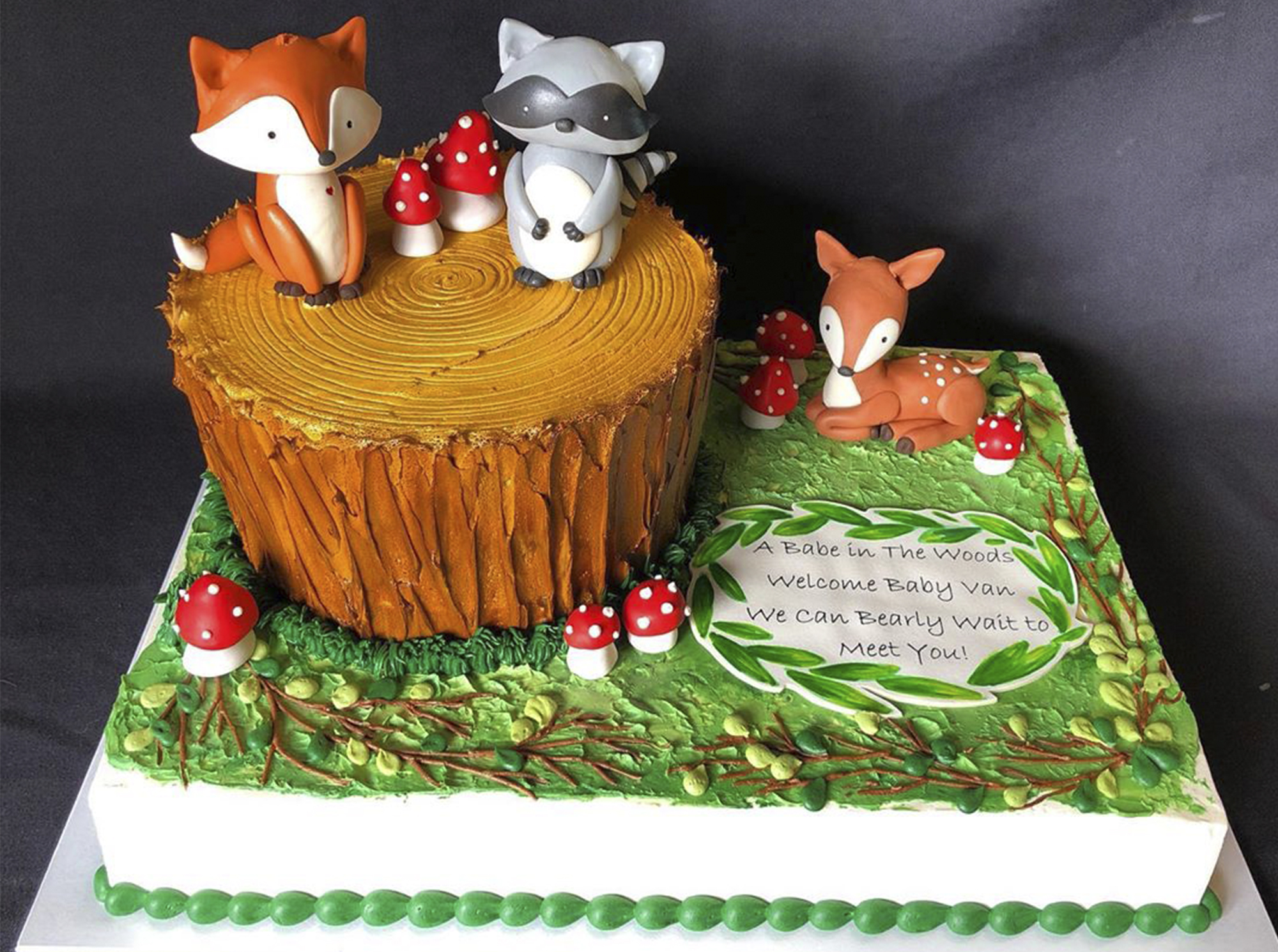 Fancy forst cake with foxes and mushrooms posing on a log