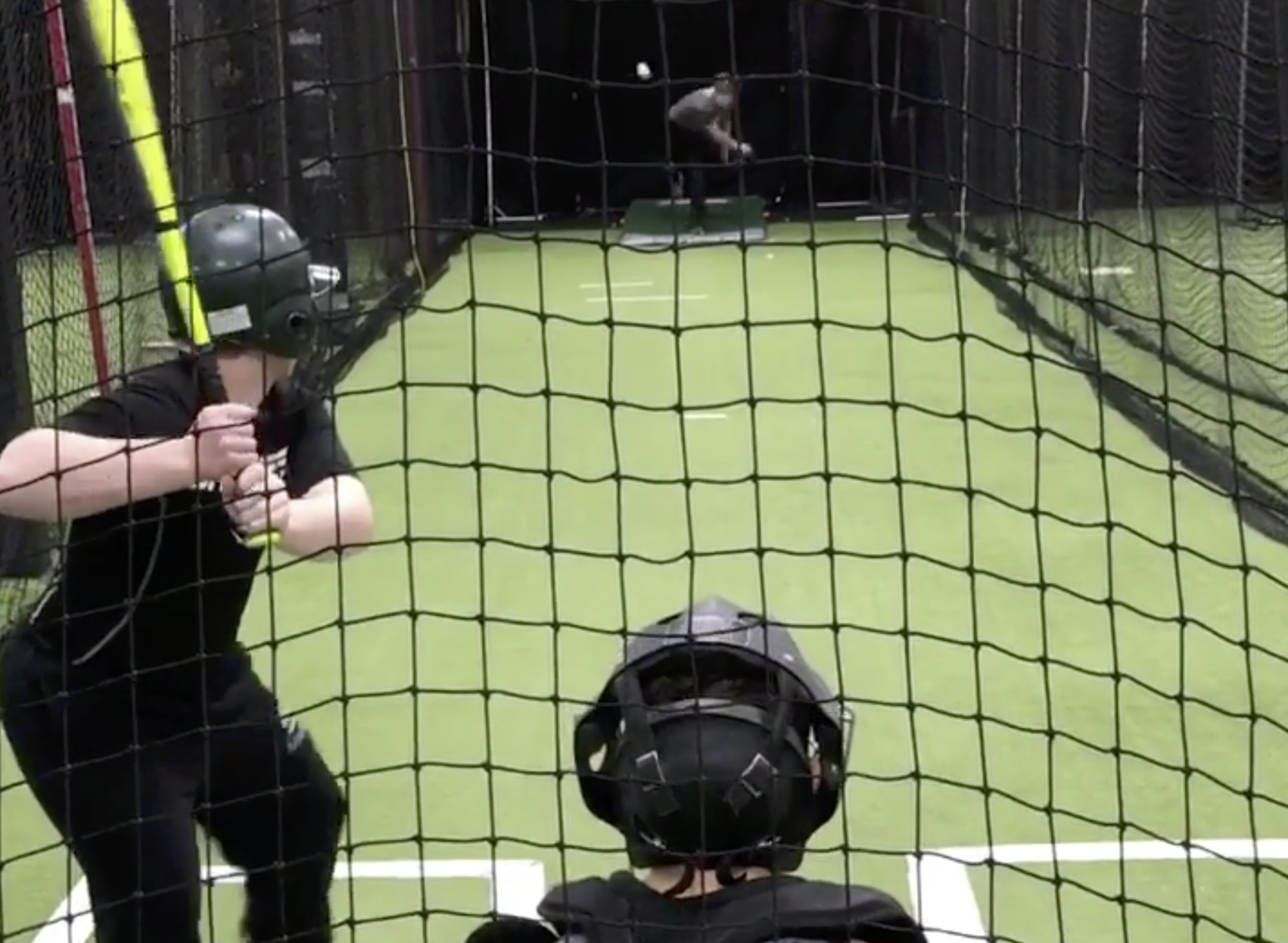 Pre-eten ready to swing in batting cage