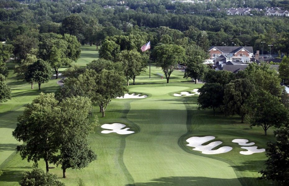 aerial shot of golf course with sand traps