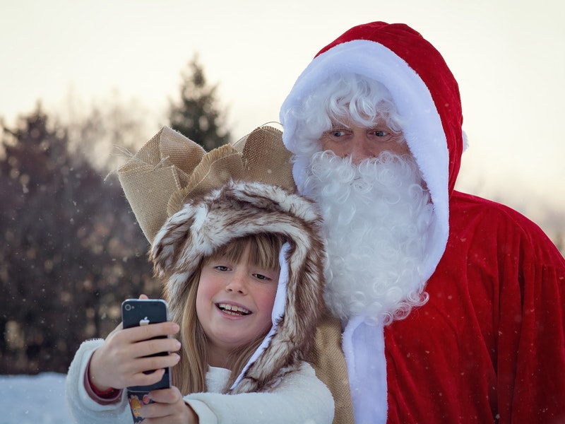 kid takes picture with santa