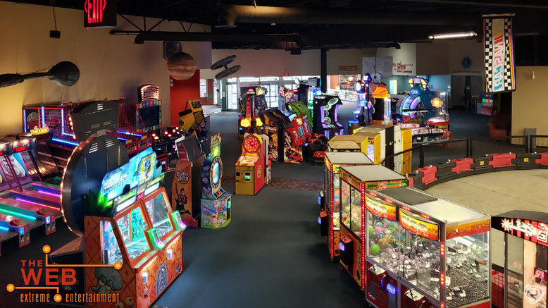 A large room filled with arcade stuff
