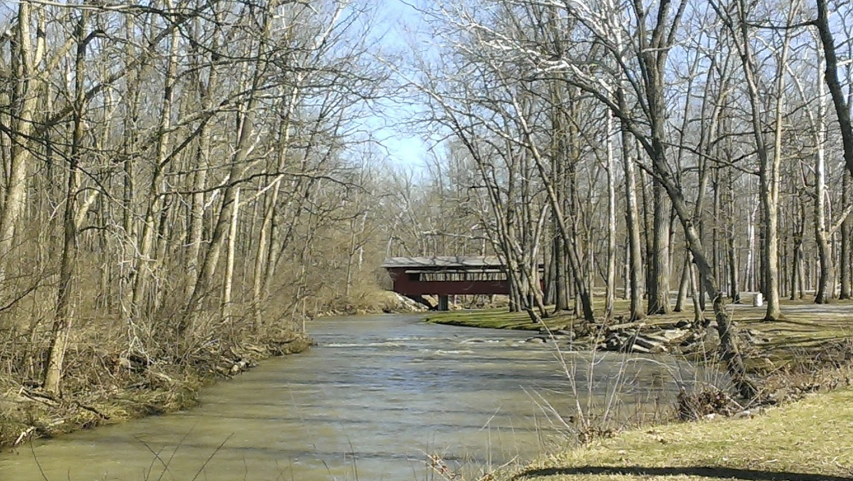 Landscape of Tawawa park with covered bridge over a river in the distance