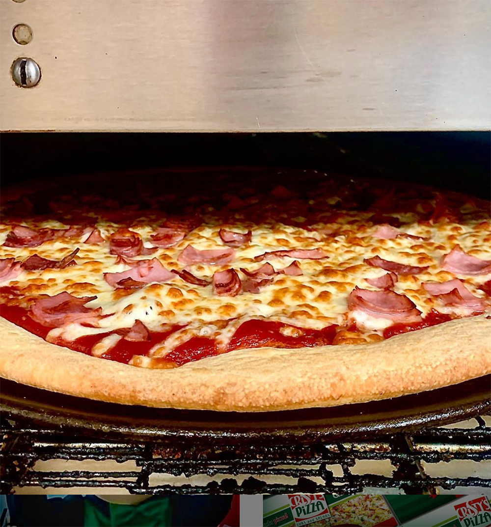 Ham and cheese pizza fresh out of the oven