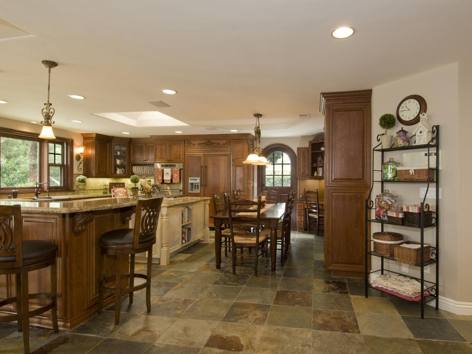 A kitchen made of hardwood and dark stone floors.