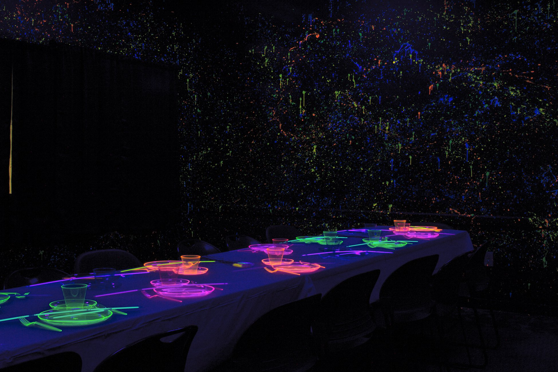 A black lit dining hall