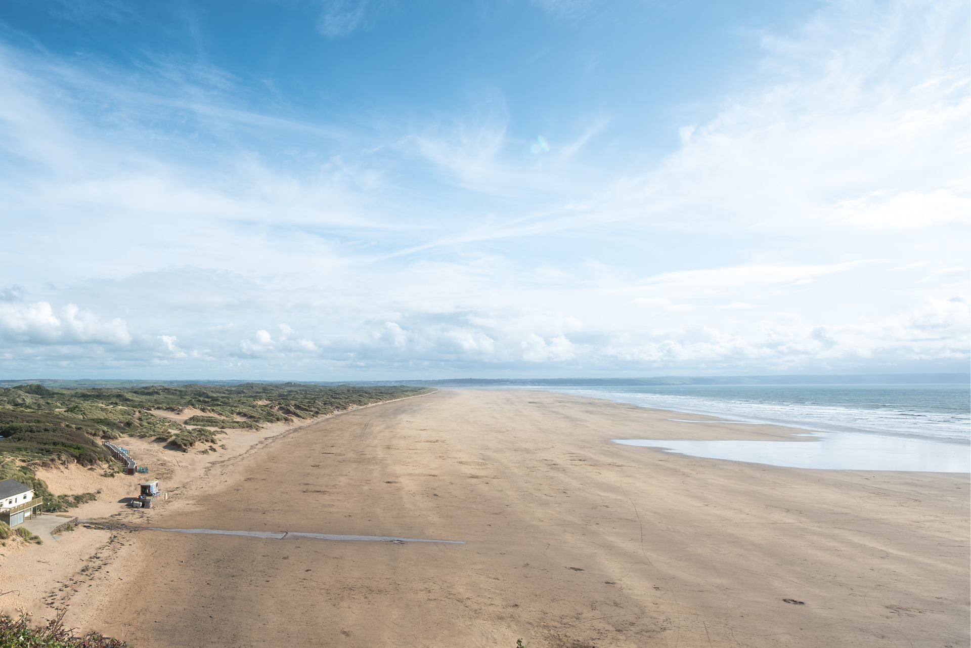 Three and a half miles of golden sands flanked by sand dunes