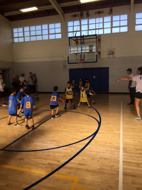 Kids playing basketball in Tiny Eagles program.