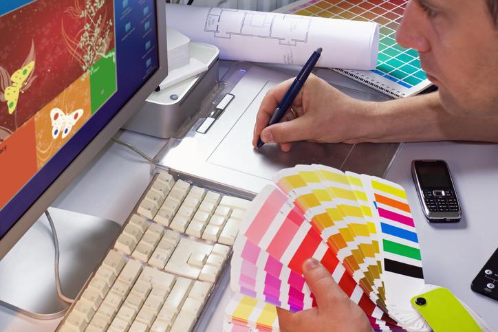 Graphic Designer Creating A Design