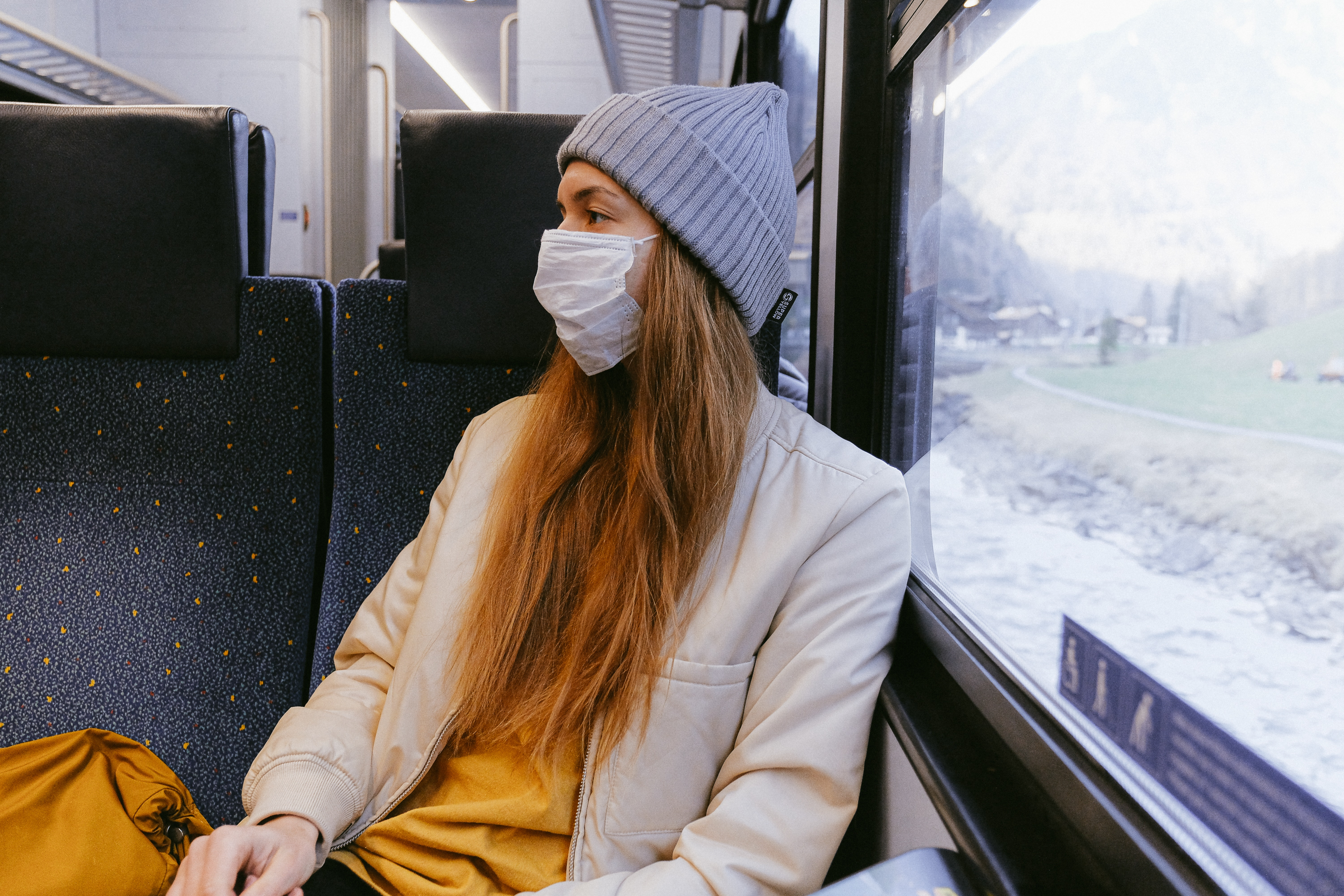 Riding a train with a mask on