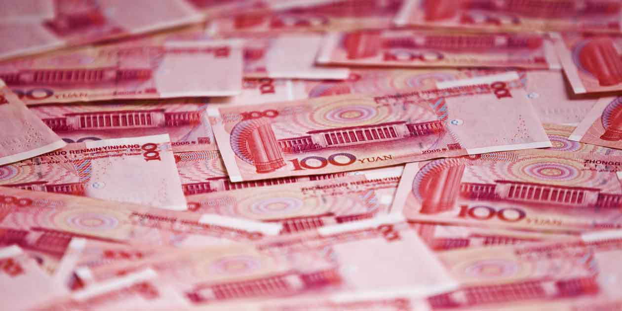 Piles of 100 notes of Chinese Yuan — AidData releases first ever dataset on Chinese global development spending