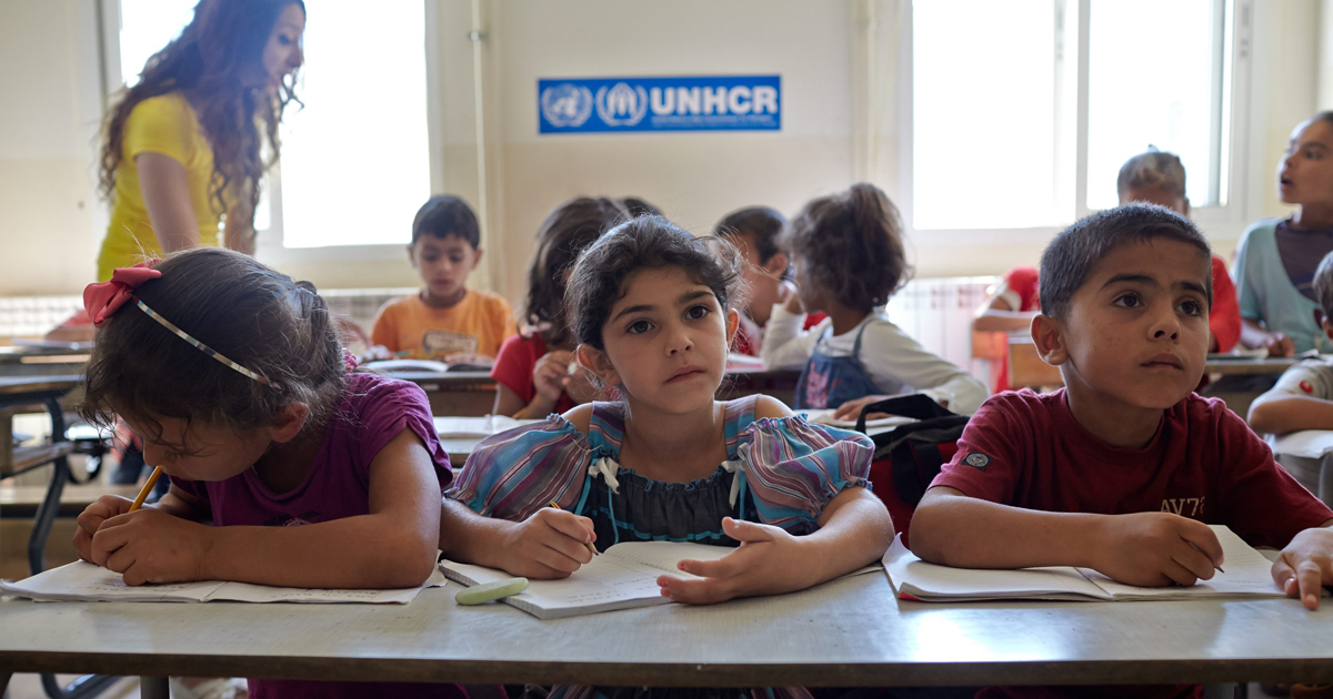 Syrian refugee students attend a class in an accelerated learning program at public school in Kamed Al Louz in the Bekaa Valley, Lebanon. Photo by Shawn Baldwin/UNHCR, licensed under (CC BY-NC 2.0).